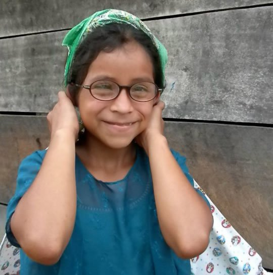 Young girl enjoying her new glasses