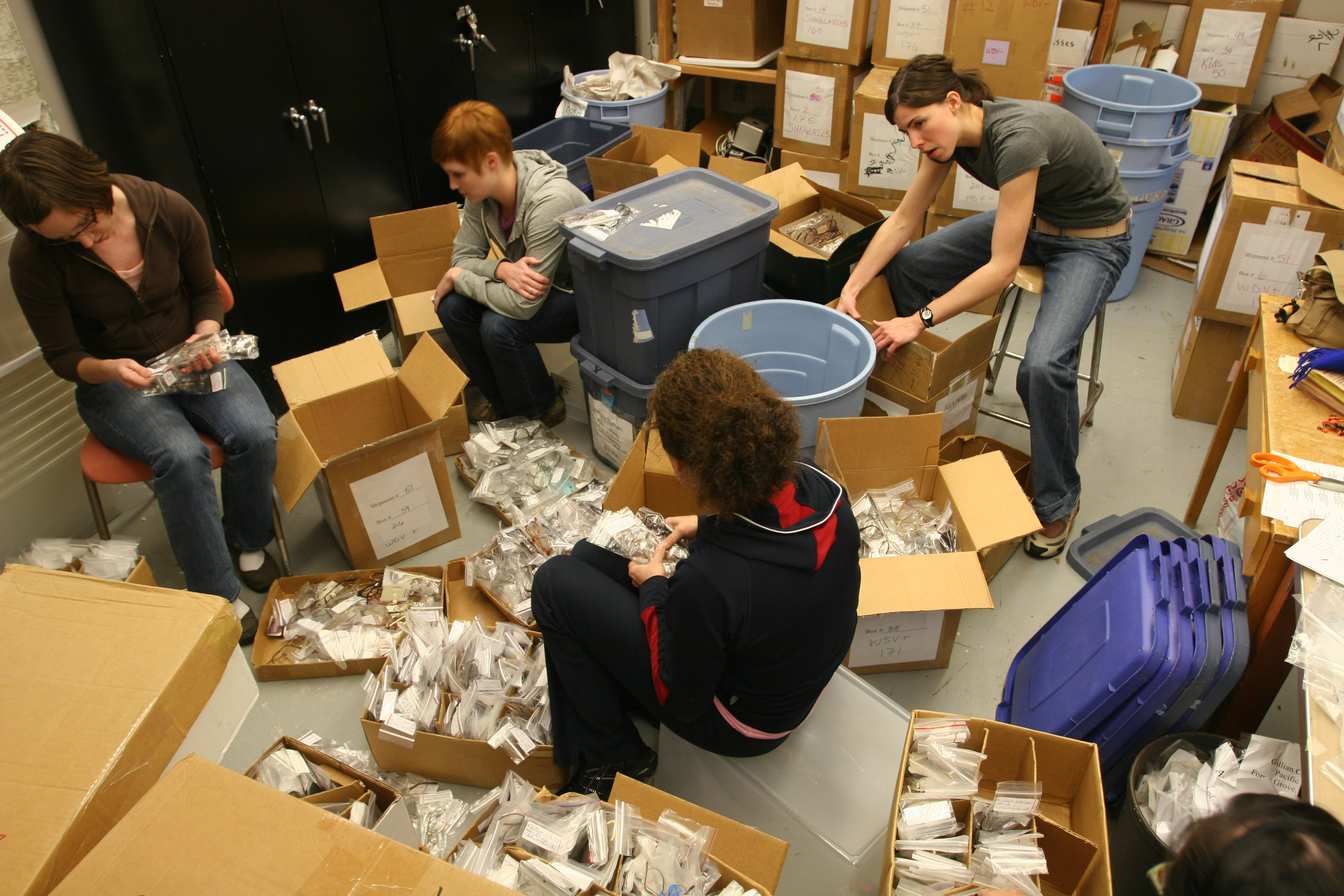 Amigos volunteers prepare hundreds of eye glasses for the mission trip to Ixcan, Guatemala