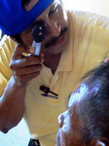 Felipe using his new Heine ophthalmoscope 360x