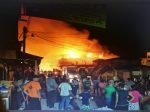 Residents helplessly look on as fire consumes the central market