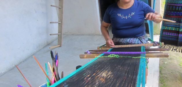 Thanks to EI and a paire of glasses, Teresa can see to continue weaving.