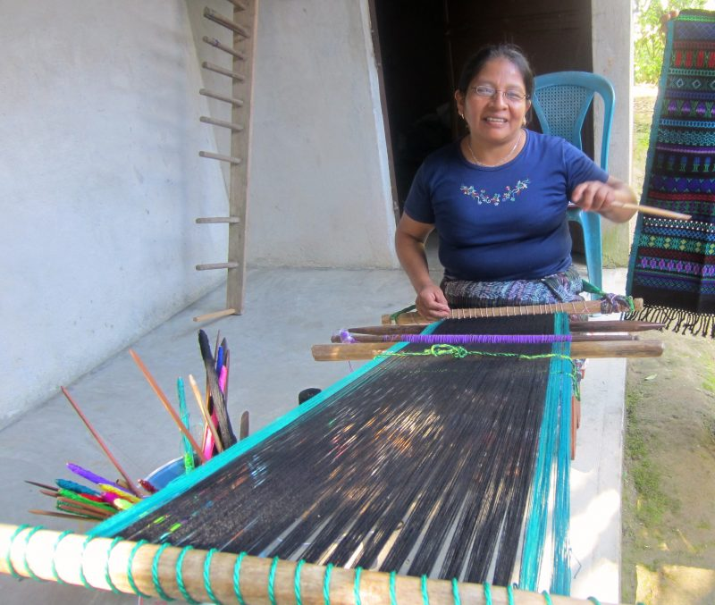 Thanks to EI and a pair of glasses, Teresa can see to continue weaving.